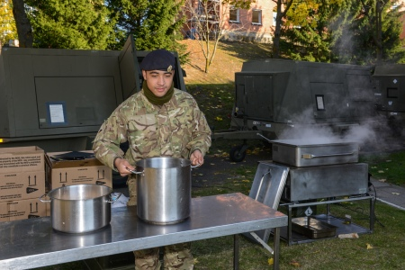 "Army Chefs in Vilnius, Lithuania. As the soldiers of 248 Gurkha Signal Squadron are hard at work building the set up in Vilnius, Chefs from 22 Signal Regiment now have their equipment and immediately set to work to keep the guys fed. At the moment it is simple fare, using the contents of 10 man ration boxes, but these will be supplemented by fresh food in the coming days. This deployment marks the first time HQ ARRC has conducted their annual exercise, named ARRCADE FUSION 2015 (AF 15), in the Baltics with participation and elements in all 3 nations of Lithuania, Latvia and Estonia. ""From the logistic point of view it is an excellent opportunity to test the strategic deployment of our personnel and material"", said Brigadier Torsten Gersdorf, commander of Enabling Command ARRC. About 350 logistics vehicles and more than 150 containers of equipment left the ship MV EDDYSTONE and departed in convoys driven by 14 Transport Squadron and elements of 27 Regiment RLC to the various exercise locations in Lithuania and Latvia. This non-tactical movement signifies the start of this yearÕs AF 15 from a support perspective. This exercise tests the headquarters' ability to control simulated troop formations within a challenging and dynamic fictional scenarios. The scenario planned for AF 15 provides exercise evaluators with the ability to merge realistic global security threats into one environment to challenge and test the ability of headquarters personnel to devise innovative and pragmatic solutions. This is made all the more challenging, as they will be deploying in the middle of a Baltic winter in tents and field conditions. In this image:  Private Zaque Edwards, 25 from Stoke-on-Trent, 22 Signal Regiment, boils pasta on a quick field set up. Please credit photographer."